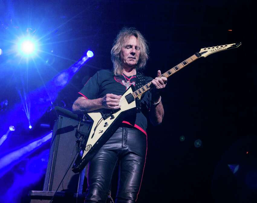 In this Oct. 24, 2015 file photo, Glenn Tipton of Judas Priest performs at the 2015 Knotfest USA in San Bernardino, Calif. Tipton is stepping down from touring due to Parkinson?'s disease, a condition that began to afflict him a decade ago. He will be replaced on the band's