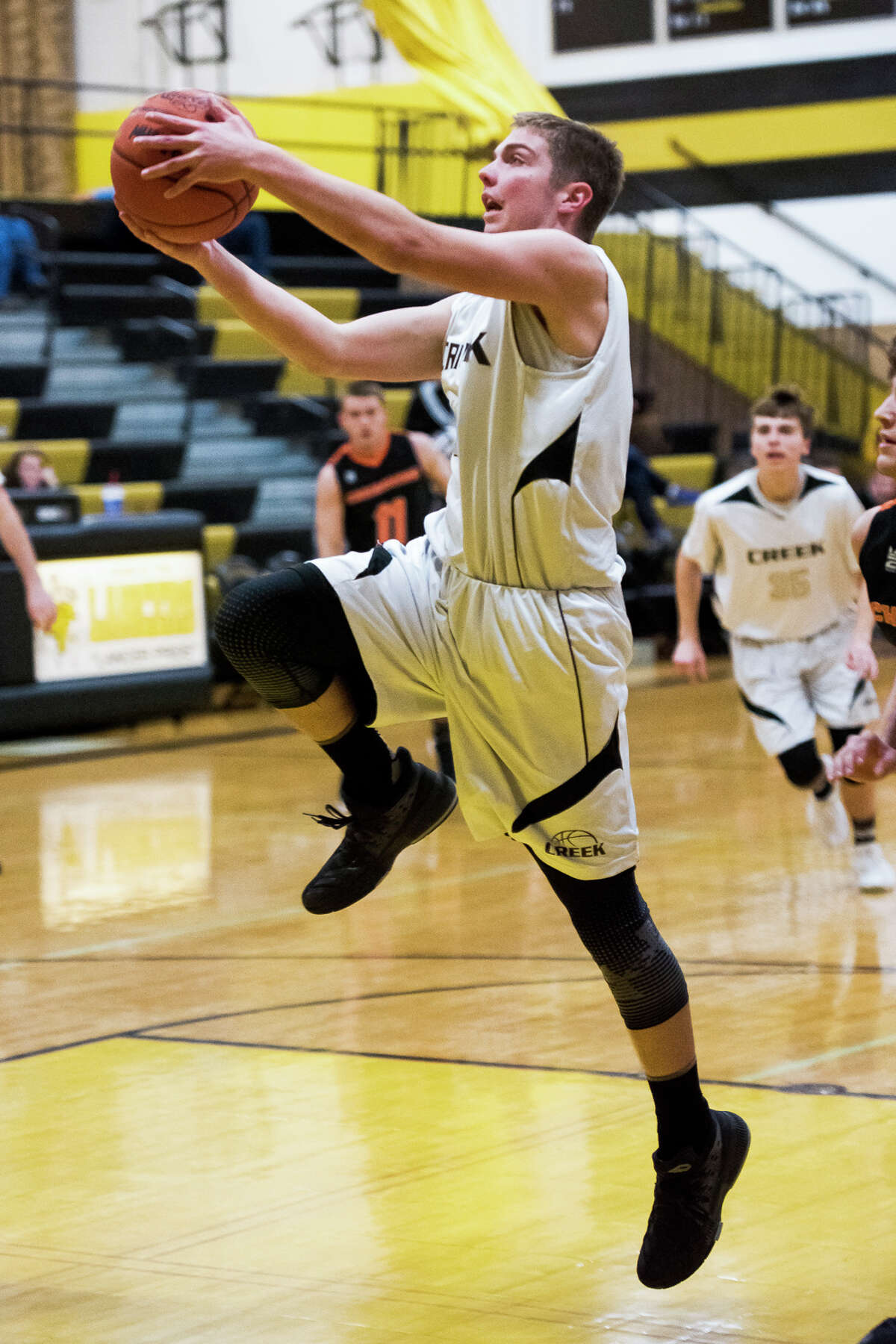 Bullock Creek senior Josh Zastrow goes for a layup during a basketball game against the Chesaning Indians at Bullock Creek High School on Monday, Feb. 12, 2018. (Danielle McGrew Tenbusch/for the Daily News)