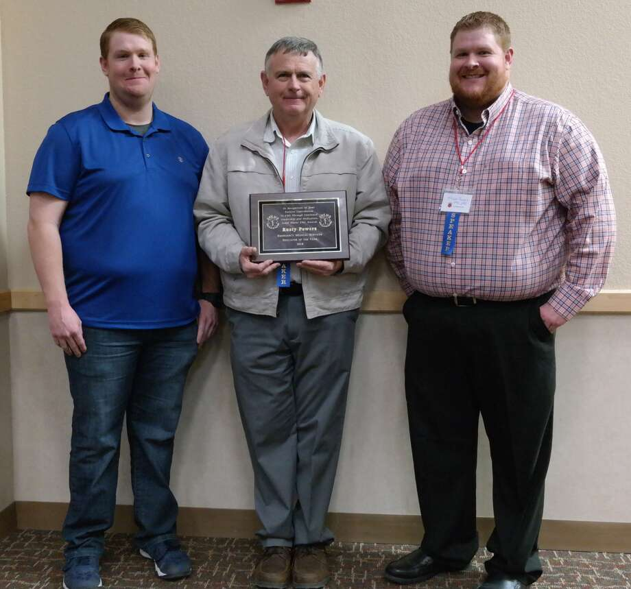 Plainview Firefighter Chief Rusty Powers (center) was named the South Plains EMS Educator of the Year. Here he stands with his two sons Tyeson and Mason who presented him with the award. Photo: Courtesy Photo