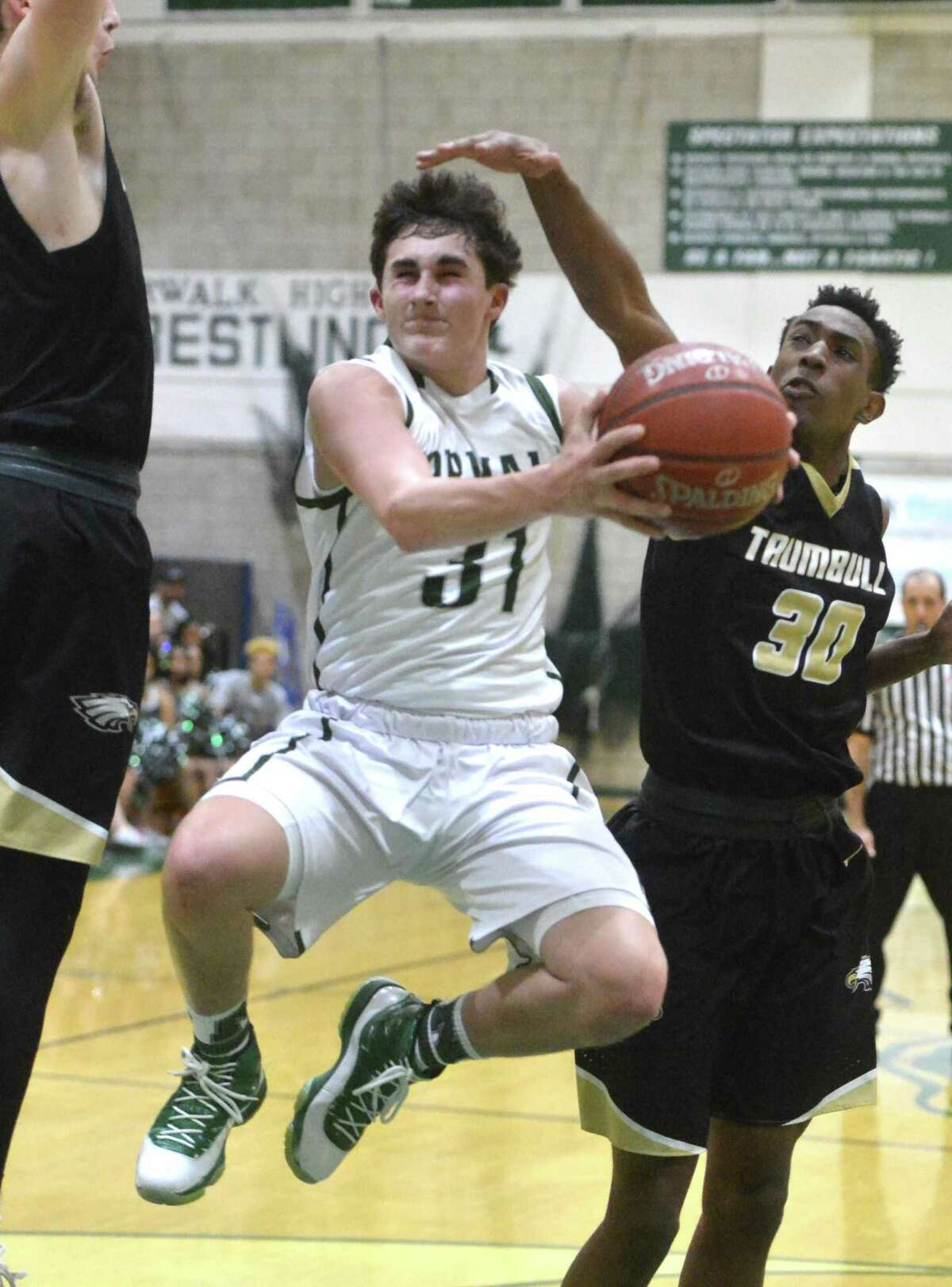 Norwalk High's Joseph Benincaso drives to the basket against Trumbull High Monday night in Norwalk. The Bears improved to 11-6 with a