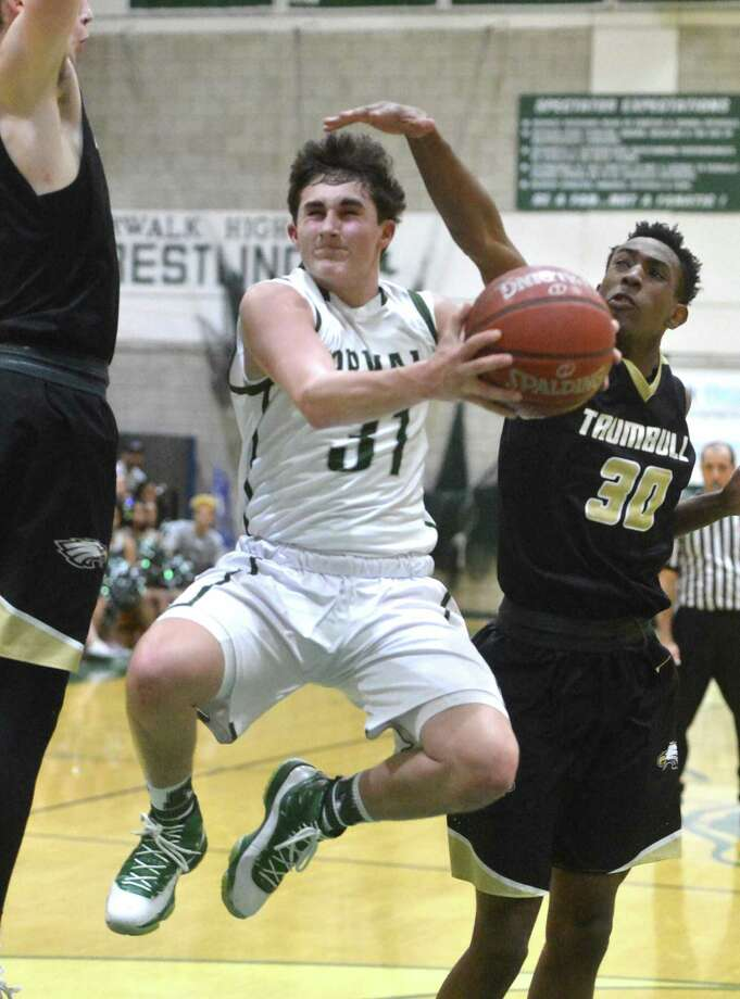 Norwalk High's Joseph Benincaso drives to the basket against Trumbull High Monday night in Norwalk. The Bears improved to 11-6 with a Photo: Alex Von Kleydorff / Hearst Connecticut Media / Norwalk Hour