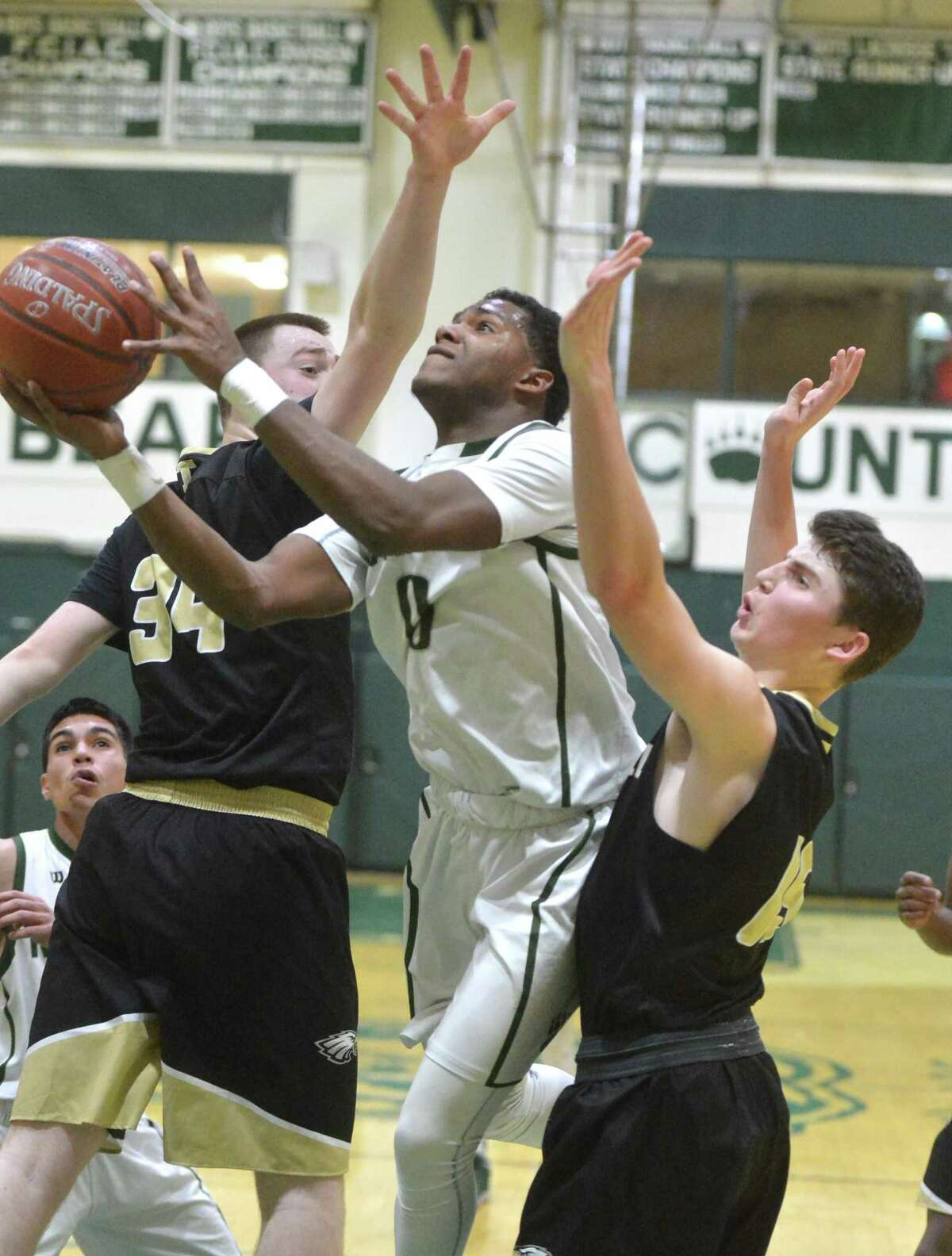 Norwalk High's # 0 Tyrique Langley shoots and scores vs. Trumbull High School in boys basketball action on Monday February 12, 2018 in Norwalk Conn.
