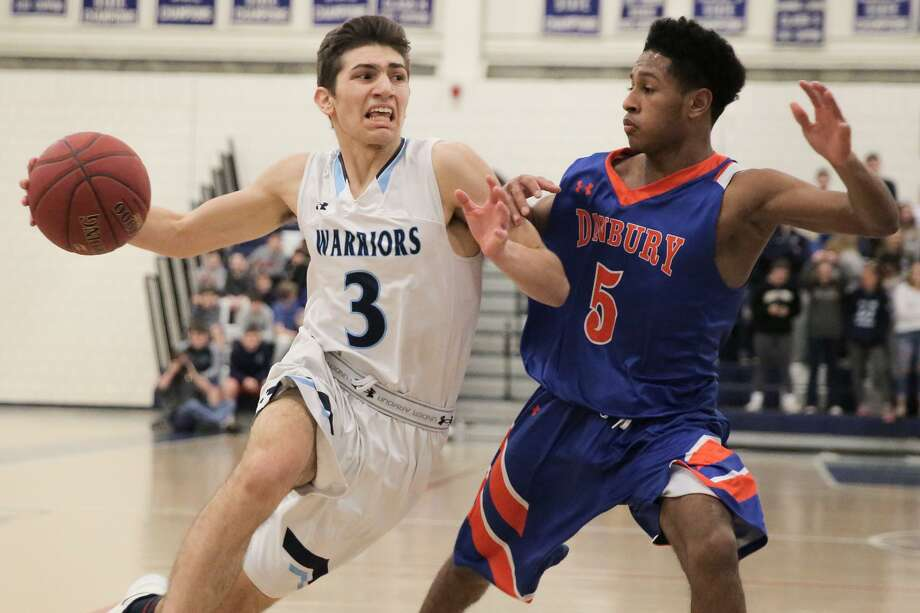 Wilton's Antonio Brancato takes the ball to the hole against Danbury's Javan Hernandez during their game at Wilton High School in Wilton, Conn. on Monday, February 12, 2018. Photo: Chris Palermo / For Hearst Connecticut Media / Norwalk Hour Freelance