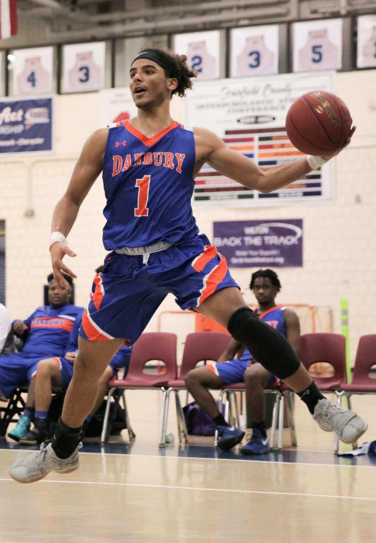 Danbury's Diante Vines leaps to recieve a pass during their game against Wilton at Wilton High School in Wilton, Conn. on Monday, February 12, 2018.