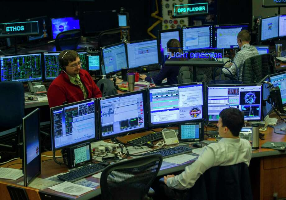Flight controllers work with the International Space Station Monday at the Johnson Space Center. Funding for the station may be eliminated after 2024. Photo: Mark Mulligan, Houston Chronicle / © 2018 Houston Chronicle