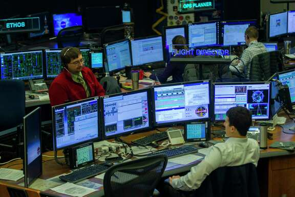 Flight controllers work with the International Space Station Monday at the Johnson Space Center. Funding for the station may be eliminated after 2024.