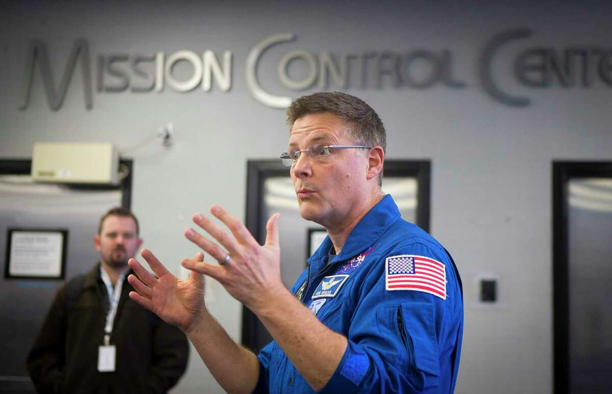 Astronaut Doug Wheelock talks with visitors outside of Mission Control during a tour of the Johnson Space Center, Monday, Feb. 12, 2018, in Houston.