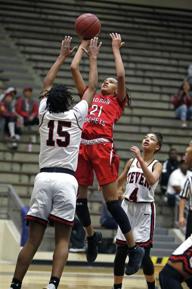 Judsons' Tiffany McGarity shoots over Stevens' Semaj Adams Class 6A bidistrict girls high school basketball game between Judson and Stevens on Monday, February 12, 2018. Photo: Ronald Cortes, For The San Antonio Express News / 2017 Ronald Cortes