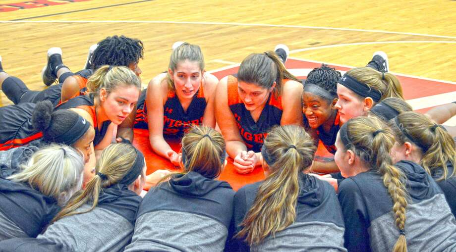 The Edwardsville girls' basketball team huddles together before the start of a regular season game at Alton. The Tigers will play Wednesday in the Class 4A Belleville East Regional.
