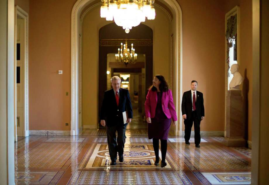 Senate Majority Leader Mitch McConnell (R-Ky.) walks to the Senate chamber on Capitol Hill in Washington, Feb. 12, 2018. With the fate of hundreds of thousands of young, undocumented immigrants in the balance, the Senate on Monday will begin an open-ended debate on immigration — an exceedingly rare step that, in effect, will allow senators to attempt to build a bill from scratch on the Senate floor. (Eric Thayer/The New York Times) Photo: ERIC THAYER / NYTNS