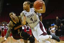 Texas Southern Tigers guard Kevin Scott (4) makes a move around Grambling State Tigers guard Nigel Ribeiro (2) as the Texas Southern Tigers take on the Grambling State Tigers during the SWAC Basketball Tournament semifinals at the Toyota Center Friday, March 10, 2017 in Houston. ( Michael Ciaglo / Houston Chronicle )