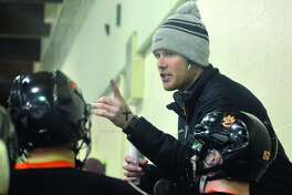 EHS coach Jason Walker talks to his team during the first-period intermission.