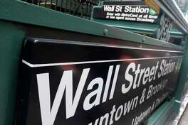FILE- This Oct. 29, 2014, file photo, shows the Wall Street subway stop on Broadway, in New York's Financial District. The U.S. stock market opens at 9:30 a.m. EST on Monday, Feb. 12, 2018. (AP Photo/Richard Drew)