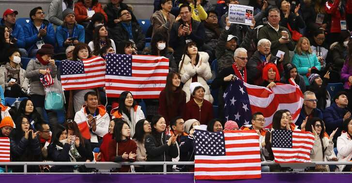 GANGNEUNG, SOUTH KOREA - FEBRUARY 12: United States fans support Mirai Nagasu of the United States as she skates during the Ladies Single Skating Free Skating section of the Team Event on day three of the PyeongChang 2018 Winter Olympic Games at Gangneung Ice Arena on February 12, 2018 in Gangneung, South Korea.  (Photo by Robert Cianflone/Getty Images)