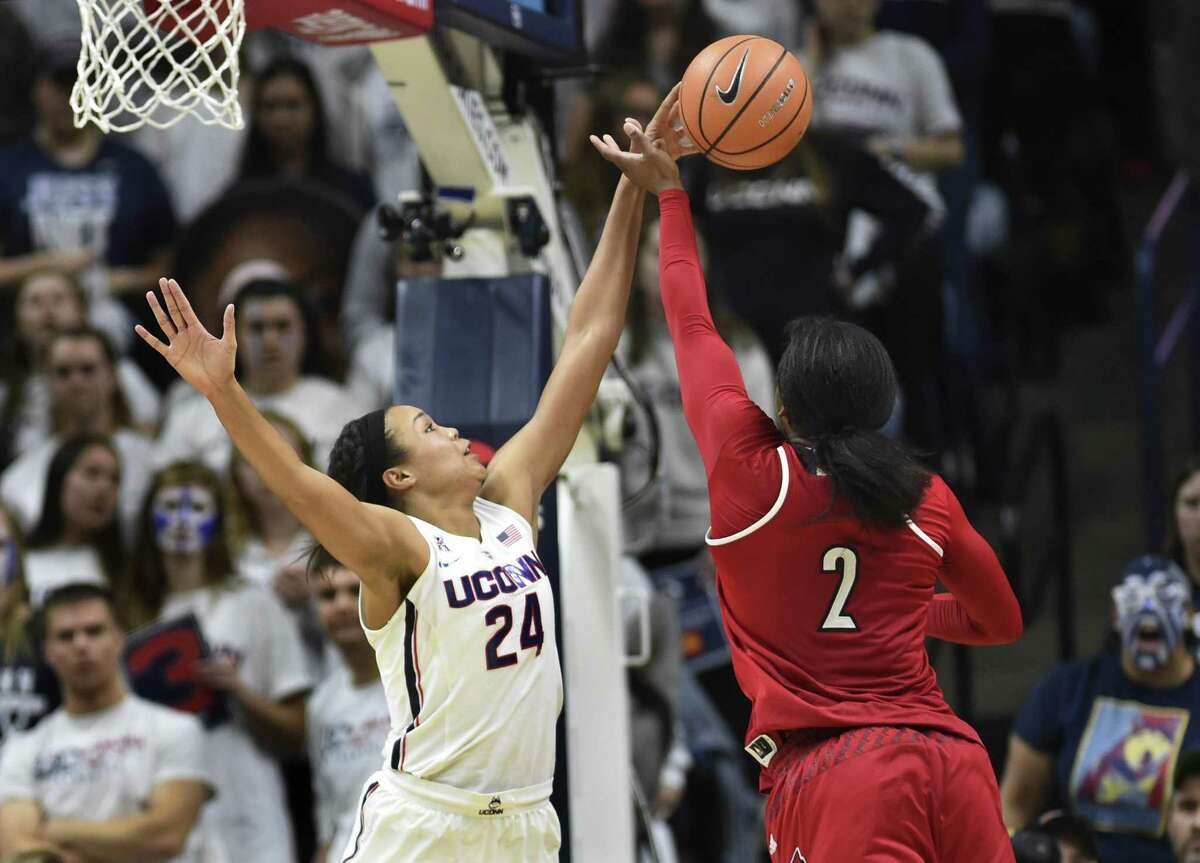 Connecticut's Napheesa Collier (24) blocks the shot of Louisville's Myisha Hines-Allen (2) in the second half of an NCAA college basketball game against fourth ranked Louisville Monday, Feb. 12, 2018, in Storrs, Conn. UConn won 69-58. (AP Photo/Stephen Dunn)