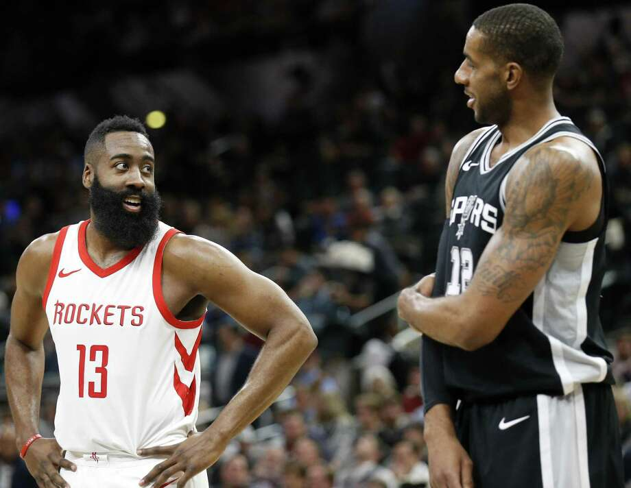 Rockets guard James Harden and Spurs forward LaMarcus Aldridge talk during a game on Feb. 1. Houston and San Antonio both stood pat at the trade deadline but are major players in the upcoming buyout market. Photo: Edward A. Ornelas /San Antonio Express-News File / © 2018 San Antonio Express-News