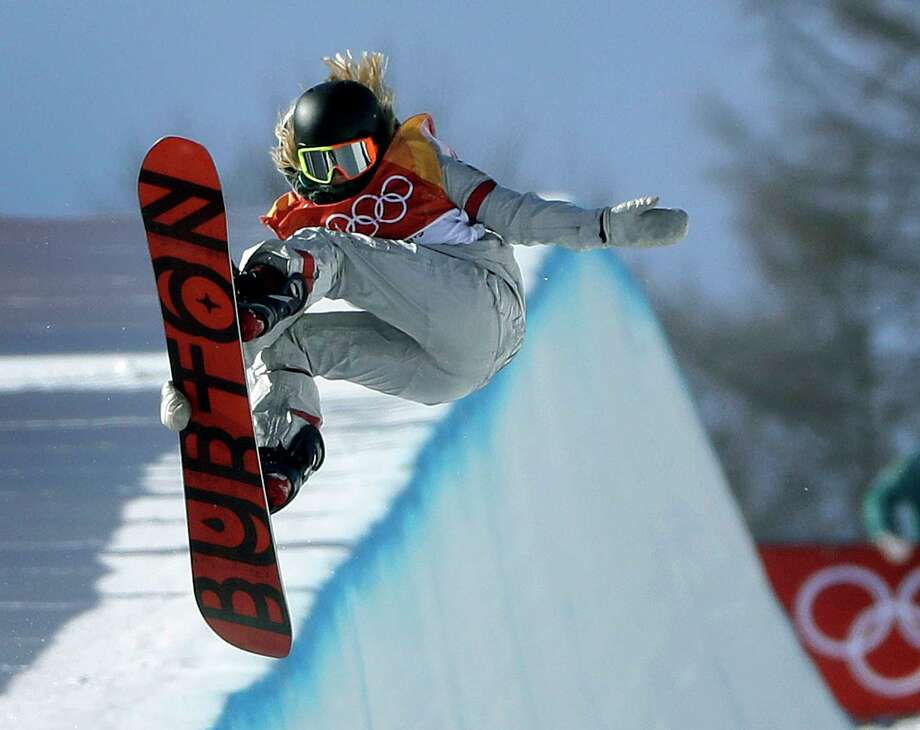 Chloe Kim, of the United States, jumps during the women's halfpipe finals at Phoenix Snow Park at the 2018 Winter Olympics in Pyeongchang, South Korea, Tuesday, Feb. 13, 2018. (AP Photo/Gregory Bull) Photo: Gregory Bull / Copyright 2018 The Associated Press. All rights reserved