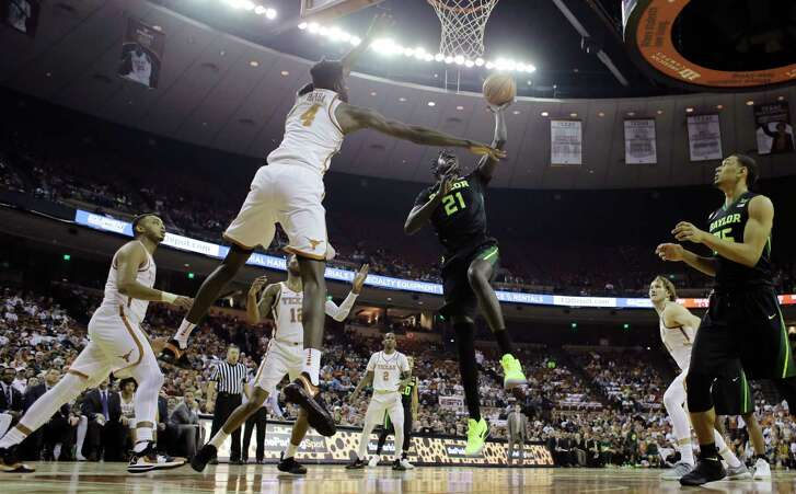 Baylor forward Nuni Omot (21) drives to the basket against Texas forward Mohamed Bamba (4) during the first half of an NCAA college basketball game, Monday, Feb. 12, 2018, in Austin, Texas. (AP Photo/Eric Gay)