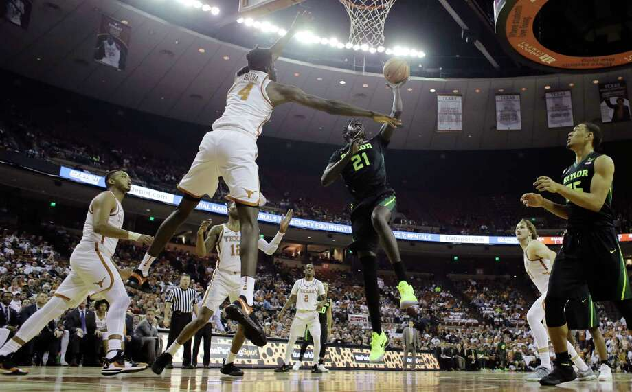 Baylor forward Nuni Omot (21) drives to the basket against Texas forward Mohamed Bamba (4) during the first half of an NCAA college basketball game, Monday, Feb. 12, 2018, in Austin, Texas. (AP Photo/Eric Gay) Photo: Eric Gay, Associated Press / Copyright 2018 The Associated Press. All rights reserved.