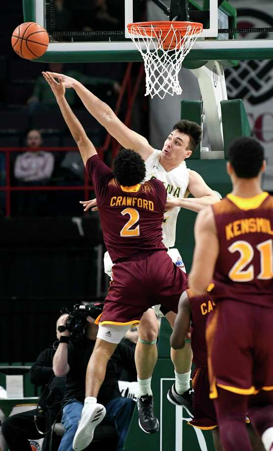 Siena's forward Evan Fisher (32) defends against Iona's forward E.J. Crawford (2) during the first half of an NCAA men's college basketball game Monday, Feb. 12, 2018, in Albany, N.Y. (Hans Pennink / Special to the Times Union) Photo: Hans Pennink / Hans Pennink