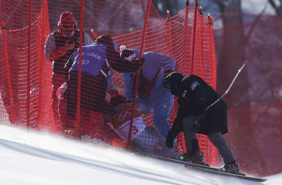 Officials assist Russia's Pavel Trikhichev after he crashed during the downhill portion of the men's combined at the 2018 Winter Olympics in Jeongseon, South Korea, Tuesday, Feb. 13, 2018. Photo: Luca Bruno, AP / Copyright 2018 The Associated Press. All rights reserved