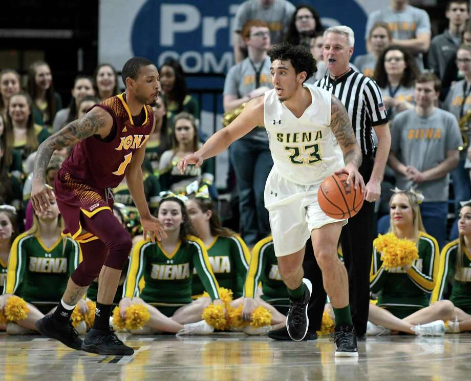 Iona's guard Zach Lewis (1) defends against Siena's guard Jordan Horn (23) during the first half of an NCAA men's college basketball game Monday, Feb. 12, 2018, in Albany, N.Y. (Hans Pennink / Special to the Times Union) Photo: Hans Pennink / Hans Pennink