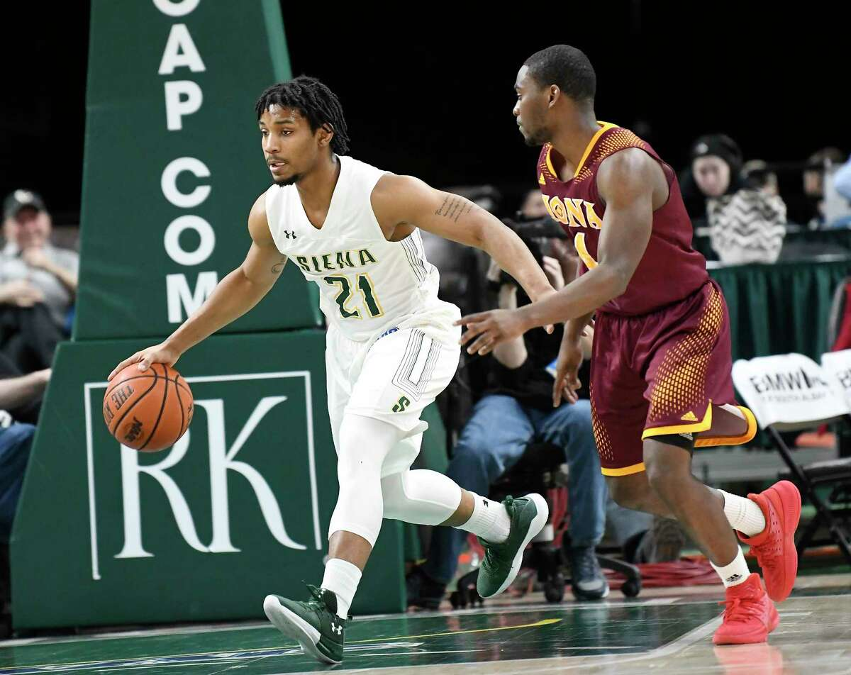 Siena's guard Ahsante Shivers (21) moves the ball against Iona's guard Schadrac Casimir (4) during the first half of an NCAA men's college basketball game Monday, Feb. 12, 2018, in Albany, N.Y. (Hans Pennink / Special to the Times Union)