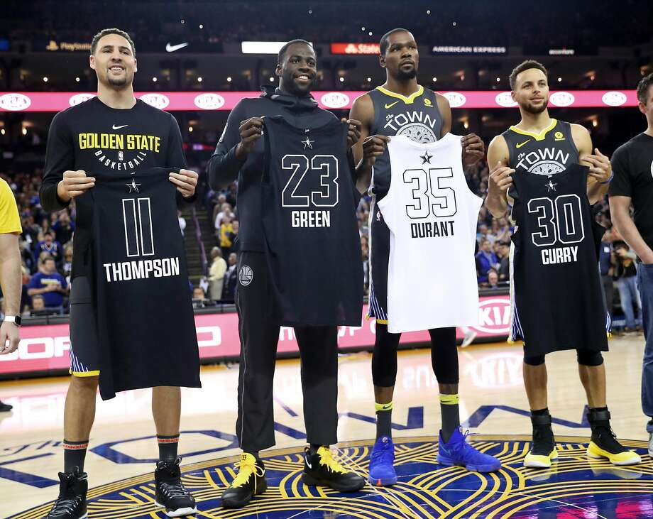 Golden State Warriors' Klay Thompson, Draymond Green, Kevin Durant and Stephen Curry pose with their All Star Game jerseys before playing  Phoenix Suns during NBA game at Oracle Arena in Oakland, Calif., on Monday, February 12, 2018. Photo: Scott Strazzante, The Chronicle