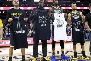 Golden State Warriors' Klay Thompson, Draymond Green, Kevin Durant and Stephen Curry pose with their All Star Game jerseys before playing  Phoenix Suns during NBA game at Oracle Arena in Oakland, Calif., on Monday, February 12, 2018.