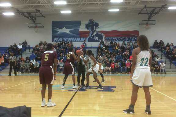 Summer Creek's Burgandi Griffin (32) and Pasadena Memorial's Abigail Samson (24) get ready for the tip-off to start their opening round bi-DIstrict playoff game Mon. night Feb. 12 at Sam Rayburn High School in Pasadena