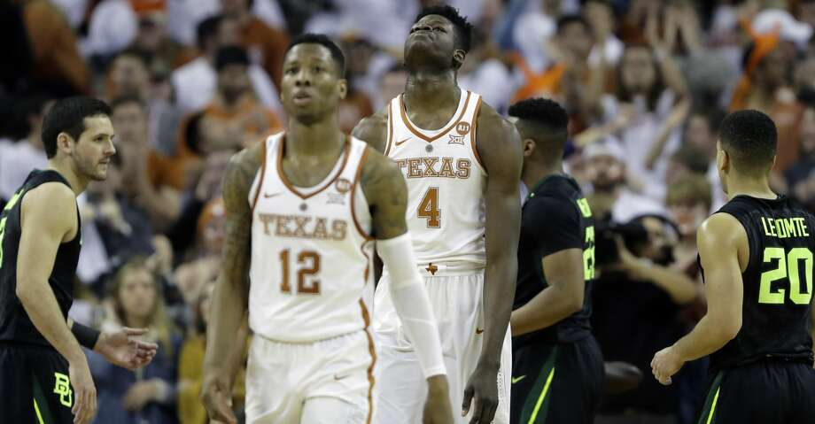 Texas forward Mohamed Bamba (4) and guard Kerwin Roach II (12) walk off the court during an NCAA college basketball game against Baylor, Monday, Feb. 12, 2018, in Austin, Texas. Baylor won 74-73 in double overtime. (AP Photo/Eric Gay) Photo: Eric Gay/Associated Press