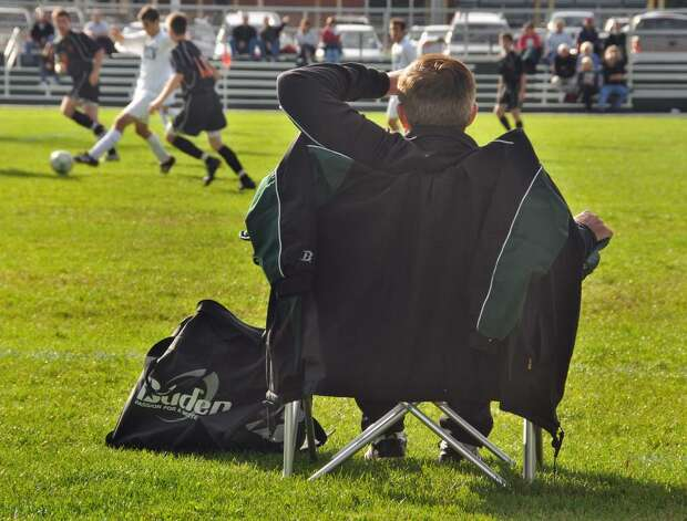 Shenendehowa boys' soccer coach Mike Campisi, who recently won his 500th game, coaches games from his lawn chair. (John Carl D'Annibale / Times Union) Photo: John Carl D'Annibale / 00005818A