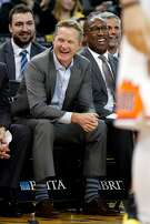 (left to right) Golden State Warriors' coaches' Chris DeMarco, Steve Kerr, Mike Brown and Bruce Fraser enjoy the 3rd quarter of Warriors' 129-83 win over Phoenix Suns during NBA game at Oracle Arena in Oakland, Calif., on Monday, February 12, 2018.