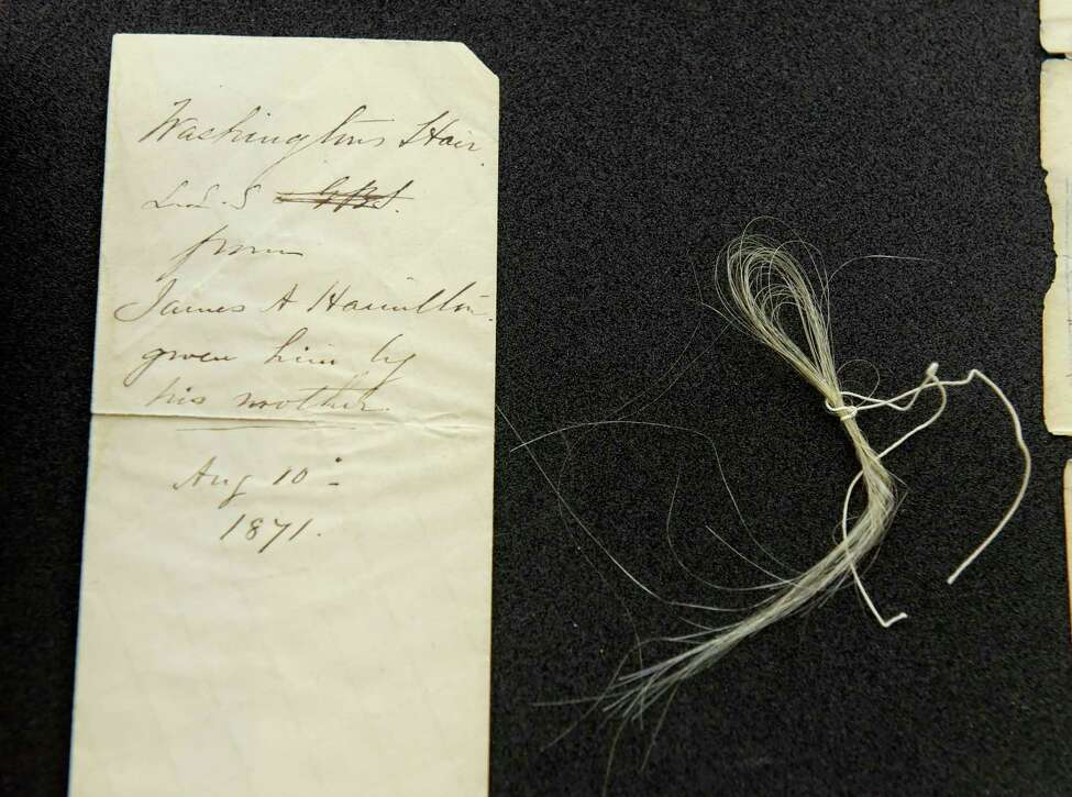 An envelope and strands of George Washington's hair seen here at Union College on Thursday, Feb. 8, 2018, in Schenectady, N.Y. (Paul Buckowski/Times Union)
