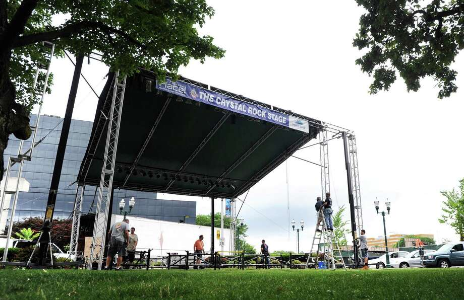 Workers set up in July 2016 the Crystal Rock Stage for Alive@Five in Stamford, Conn., with the stage sponsored by Crystal Rock Holdings. On Feb. 12, 2018, Cott announced a $35 million tender offer for shares of Watertown-based Crystal Rock, which provides water cooler service and office supplies throughout Connecticut and the region. Photo: Bob Luckey Jr. / Hearst Connecticut Media / Greenwich Time
