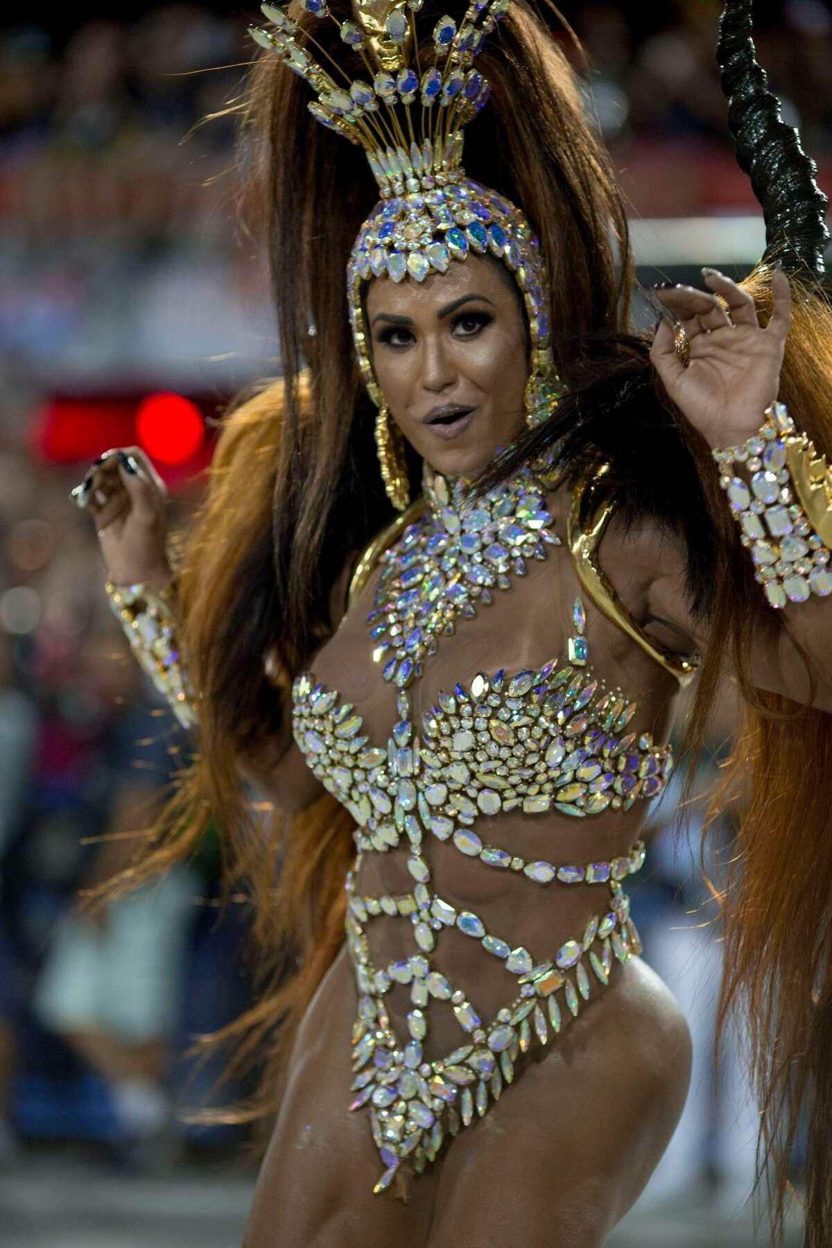 A reveler of the Uniao da Ilha samba school performs during the second night of Rio's Carnival at the Sambadrome in Rio de Janeiro, Brazil, on February 13, 2018.