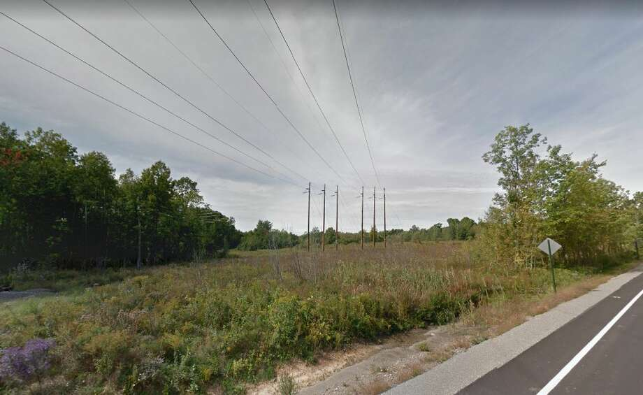Power lines transverse the Stillwater parcels off Graves Road that D.A. Collins acquired from the Luther Forest Technology Campus Economic Development Corp. These lines enter the property at County Road 75. Photo: Rulison, Larry, Google Maps