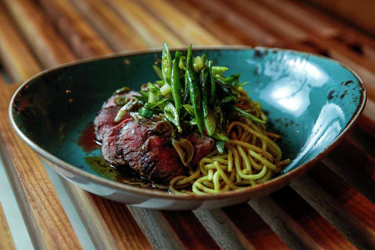 Pan-roasted 44 Farms sirloin served with cold noodles and green beans at Night Heron in Montrose.