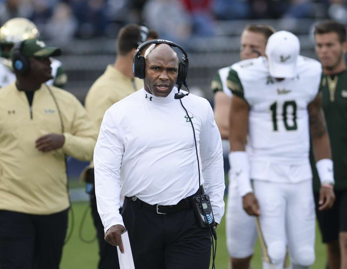 FILE - In this Nov. 4, 2017, file photo, South Florida head coach Charlie Strong works the sidelines in the second half of an NCAA college football game against Connecticut in East Hartford, Conn. When the No. 13-ranked UCF Knights and No. 22 South Florida Bulls tangle in their annual rivalry game, it's always an emotion-filled grudge match.USF won, 37-20. (AP Photo/Stephen Dunn, File)