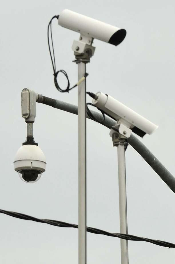 Traffic cameras monitor for accidents but can also track a car by model, color and license plate number. Photo: File Photo / Stamford Advocate