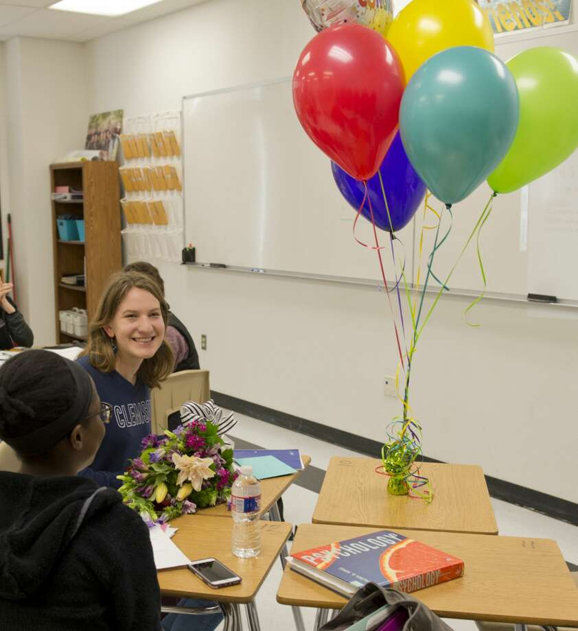 Courtney Calloway, a junior at Lee High, is presented with flowers and balloons  02/13/18 with the news that she is a National Merit Scholarship finalist. Tim Fischer/Reporter-Telegram Photo: Tim Fischer/Midland Reporter-Telegram