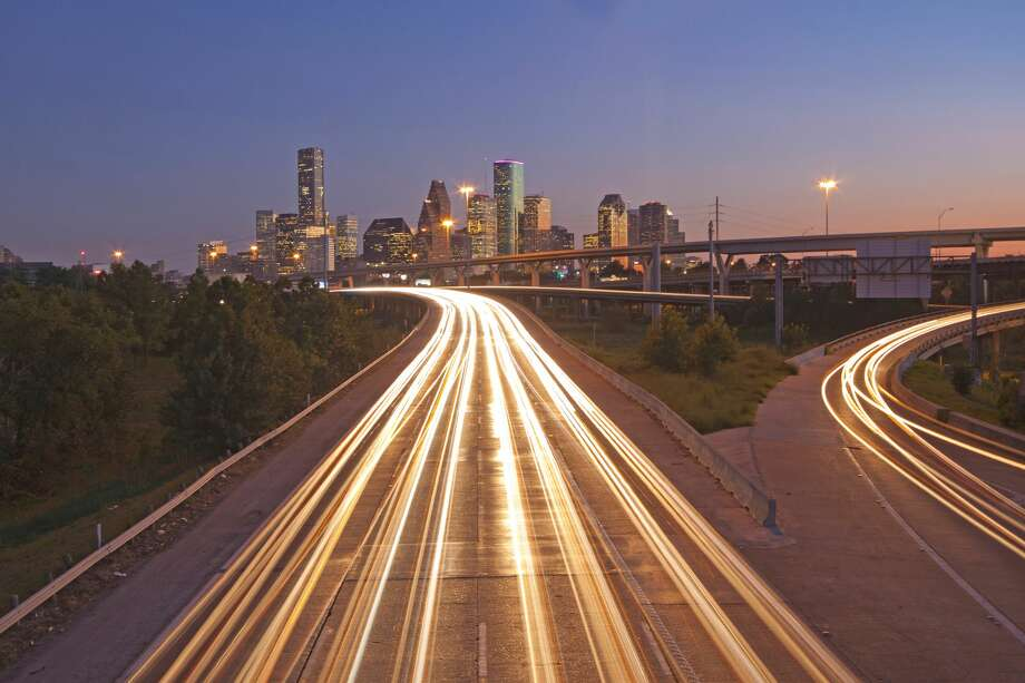 Houston, Texas skyline and highway with light trails at sunset Photo: Victoria Chen/Getty Images