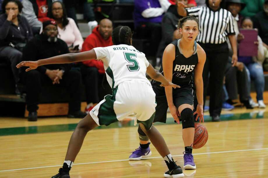 Ridge Point Panthers Taylor Thomas (C) (12) controls the ball defended by Fort Bend Hightower Hurricanes Taelor Purvis (5) in the first half during the girls high school basketball game between the Ridge Point Panthers and the Fort Bend Hightower Hurricanes at Hightower High School in Missouri City, TX on Friday, January 12, 2018. Photo: Tim Warner, Freelance / Houston Chronicle