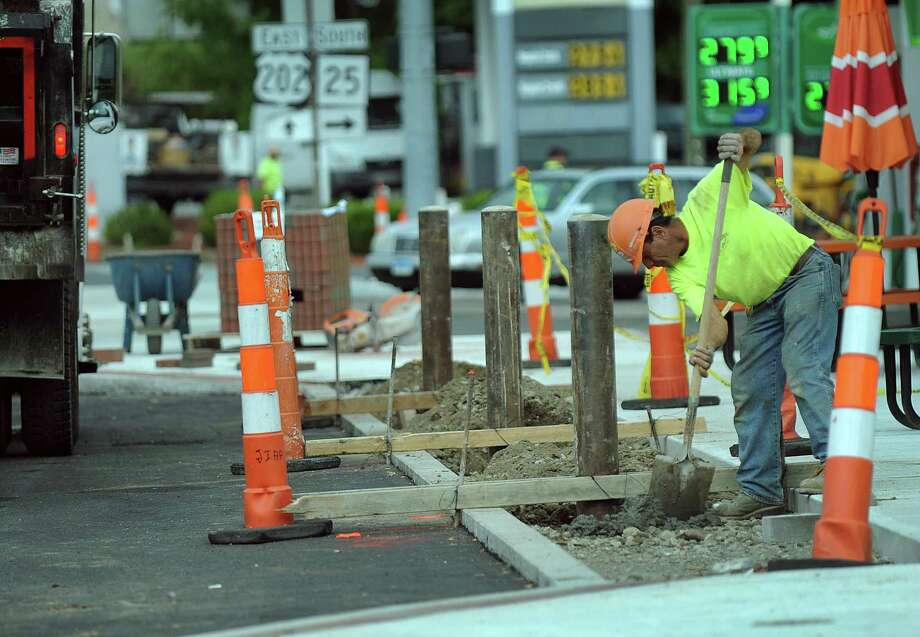 Protective bollards are being erected in street parking spaces to making parking easier for patrons visiting the Brookfield Town Center, Thursday, Sept. 14, 2017. Photo: Carol Kaliff / Hearst Connecticut Media / The News-Times