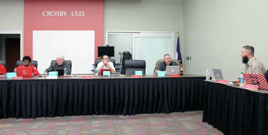 Crosby ISD's Secondary Education Executive Director Todd Hicks (right) explains to the Crosby ISD Board of Trustees how high school juniors and seniors can receive college credit with the OnRamps dual enrollment program. Photo: Kaila Contreras