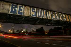 This is an iconic railroad overpass in Houston, Texas on the southbound/inbound lanes of I-45.