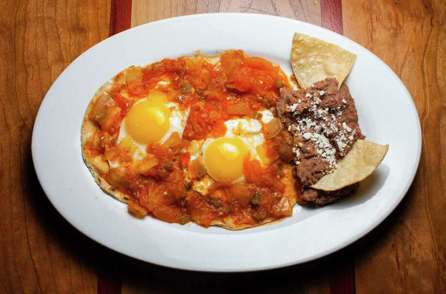 Huevos Rancheros are on the breakfast menu at Arnaldo Richards' Picos restaurant which is now serving breakfast seven days a week: weekdays from 7 to 10:30 a.m. and Saturday and Sunday from 7 a.m. to 3 p.m. Photo: Nick De La Torre / © de la Torre Photos LLC