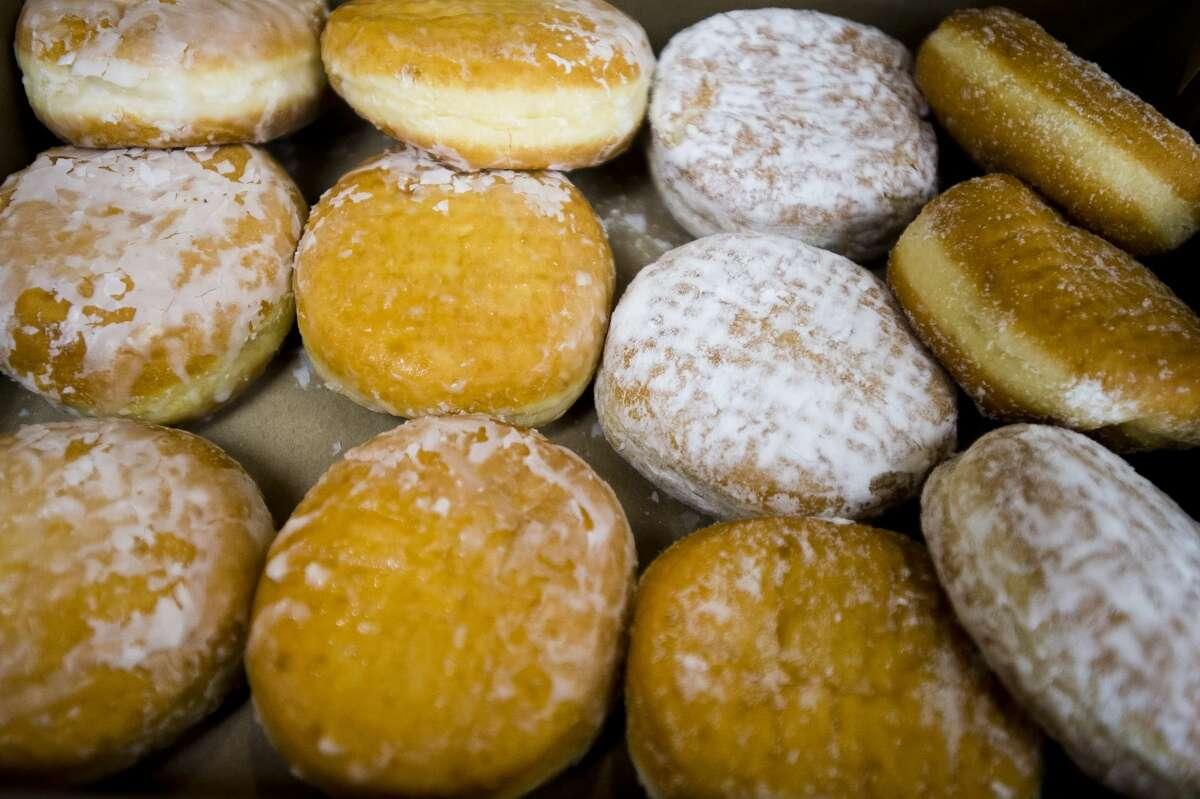 One dozen paczki are arranged in a box at the Tim Horton's on S. Saginaw Road on Fat Tuesday, Feb. 13, 2018. (Katy Kildee/kkildee@mdn.net)