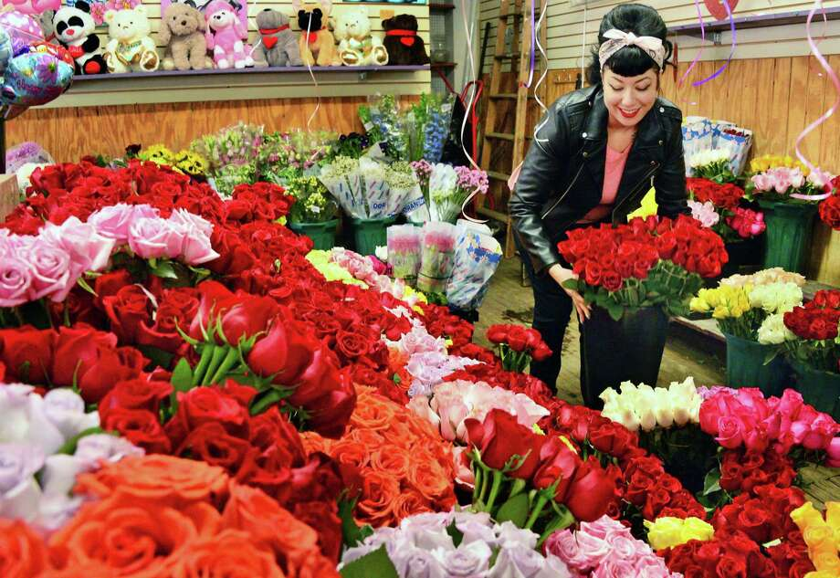 Store manager Tiffany Barkevich with some of their 8,000 roses for Valentine's Day at Lark St. Flower Market on Tuesday Feb. 13, 2018, in Albany, N.Y.  (John Carl D'Annibale/Times Union) Photo: John Carl D'Annibale, Albany Times Union / 20042920A