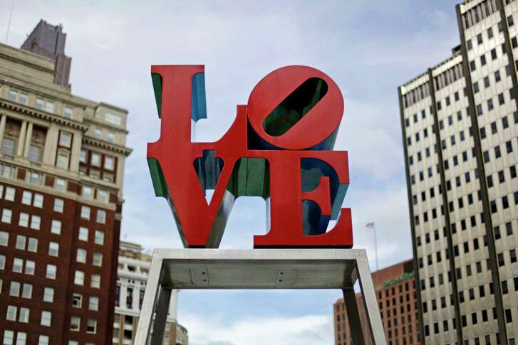 Artist Robert Indiana's LOVE sculpture in John F. Kennedy Plaza, also known as Love Park, in Philadelphia. The sculpture, temporarily relocated in 2016 before renovations to the plaza, is set to return to its traditional location Tuesday, Feb. 13, 2018, ahead of Valentine's Day. The tourist attraction has been repainted to its original colors and will be installed on a new rectangular pedestal, in keeping with how Indiana's other works are displayed.